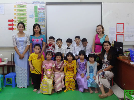 Katia Davis: After her TEFL training, Katia became a TESOL teacher in Myanmar: graduation with some of her class, all dressed up in traditional myanmar longyi